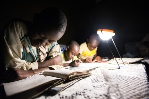 Studying by a solar lamp